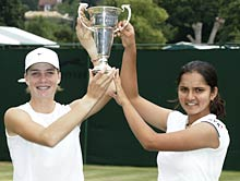 Sania and Russian Alisa Kleybanova with the Wimbledon trophy