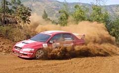 Armin Kremer of Team MRF Tyres negotiates his Mitsubishi Lancer Evo 7 through the second Special Stage at Lake City, Panshet, near Pune.