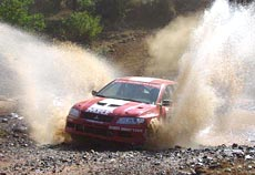 Armin Kremer (co-driver Fred Berssen) of Team MRF Tyres splash through a stream during the Leg 2 of the MRF India Rally.