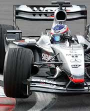 Kimi Raikkonen drives his McLaren Mercedes MP4-17D during practice