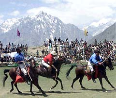 Players from the northern Pakistani mountain towns of Gilgit and Chitral play their annual polo match