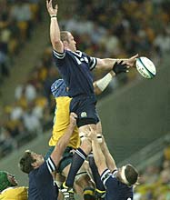 Great show: Scotland's Jason White wins the lineout from Justin Harrison of Australia during their quarter-final match