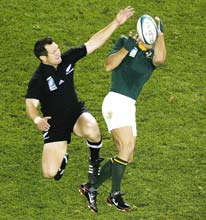 Too easy: All Blacks fullback Leon MacDonald in action during the quarter-final against South Africa