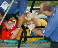 Wallaby prop Ben Darwin being stretchered off with his neck in a brace