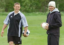 Jonny Wilkinson (L) and David Beckham have a joke during the latest adidas campaign on location at Mottram Hall