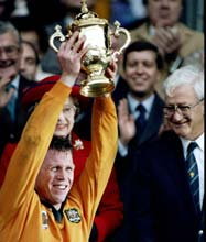 Australian captain Nick Farr-Jones lifts the trophy after their victory in the World Cup final against England