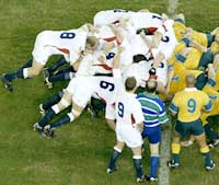 The England and Australian teams contest a scrum