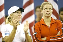Justine Henin-Hardenne (L) stands with compatriot Kim Clijsters after the women's final