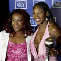 Yetunde Price with Serena Williams. Pic: Reuters