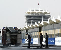 Circuit workers rinse off the new Sakhir circuit in Bahrain