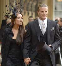 David Beckham (right) with his wife Victoria