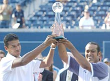 Mahesh Bhupathi (left) and Leander Paes with the ATP Masters trophy