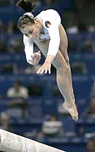 Romania's Catalina Ponor performs on the balance beam during the artistic gymnastics women's team final.