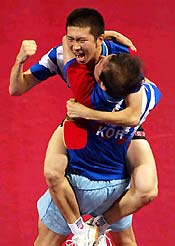 South Korea's Ryu Seung Min celebrates with his coach Kim Taek Soo