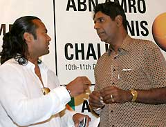 Leander Paes (left) with Vijay Amritraj