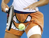 Luxembourg's Anne Kremer prepares to serve during practice for the Olympic tennis tournament in Athens, August 12, 2004.