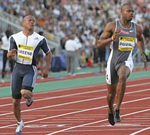 Jamaica's Asafa Powell (right) wins the men's 100m ahead of second placed Maurice Greene