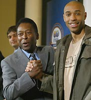 Pele (left) shakes hands with Thierry Henry during a press conference announcing the 100 greatest football players in London