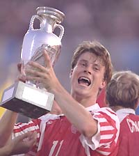 Michael Laudrup of Denmark holds aloft the European nations trophy after his team defeated Germany 2-0 in the final in Gothenburg, Sweden