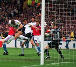 Oliver Bierhoff heads the winner for Germany
