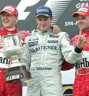 Kimi Raikkonen (centre), Michael Schumacher (left) and Rubens Barichello celebrate on the podium