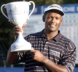 Vijay Singh poses with the Deutsche Bank Championship trophy