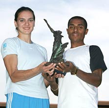 Yelena Isinbayeva of Russia and Kenenisa Bekele of Ethiopia hold the athletes of the year trophy at the IAAF World Athletics Final