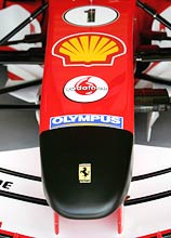The Ferrari of Michael Schumacher supports a black nose cone as a mark of respect for the death of the Pope John Paul