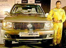 Narain Karthikeyan poses in front of the newly launched Tata Safari Dicor car in New Delhi on August 3, 2005.