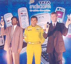 Narain Karthikeyan (centre) at the launch of Tata Indicom-Nokia mobile handsets