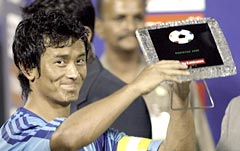 Indian football captain Bhaichung Bhutia holds the Best Player Award at the presentation ceremony of the South Asian Football Federation (SAFF) Cup on Dec 17, 2005.