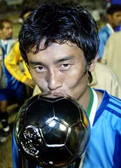 Indian football captain Baichung Bhutia kisses the SAFF Cup