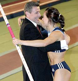 Yelena Isinbayeva (right) with Sergei Bubka