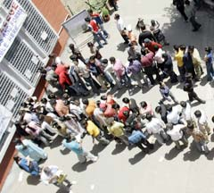 Students queue up for admission outside a college in Delhi