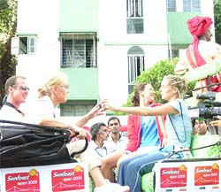 Players participating in the Sunfeast Open enjoying a buggy ride on the streets of Kolkata