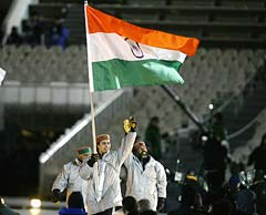 Shiva Keshavan carries the Indian flag at the opening ceremony of the Salt Lake City Winter Olympic Games in 2002