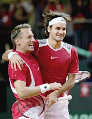Federer (right) and Yves Allegro