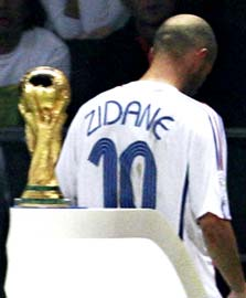 Zinedine Zidane walks past the World Cup after being sent off