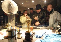 Visitors look at the Maradona display in football museum
