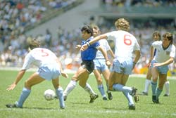 Diego Maradona takes on England during the World Cup quarter-final at the Azteca Stadium in Mexico City on June 22, 1986.