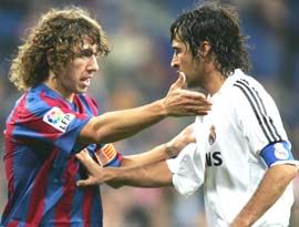 Barcelona captain Carles Puyol (left) with Raul Gonzalez
