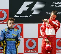 Michael Schumacher (right) celebrates as Fernando Alonso looks on dejectedly at the podium after the European Grand Prix
