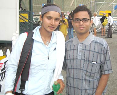 Sania Mirza with a fan.