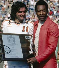 George Best presents Pele with a plaque commemorating the Brazilian as the best soccer player in the world in April 1978.