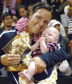 Lindsay Davenport, with son Jagger, after winning the Bali title