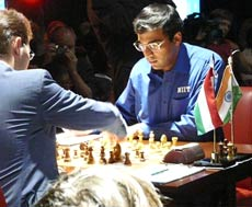 Anand on the board against Peter Leko in 14th and final round at World Chess Championships