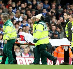 Eduardo da Silva is rushed to a hospital after injuring his left leg