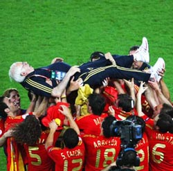 Spain coach Luis Aragones is chaired by his players following the triumph