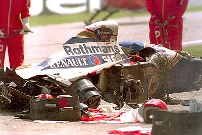 The Rothmans Williams car of Senna lies shattered on the track after he crashed into the concrete barrier during the early stages of the San Marino GP at Imola. Senna sustained serious head injuries in the accident and hospital staff pronounced him clinically dead