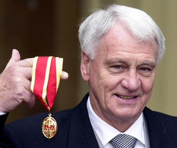Newcastle manager Bobby Robson is seen posing with his award after receiving a Knighthood at Buckingham Palace in this November 11, 2002 file photograph.